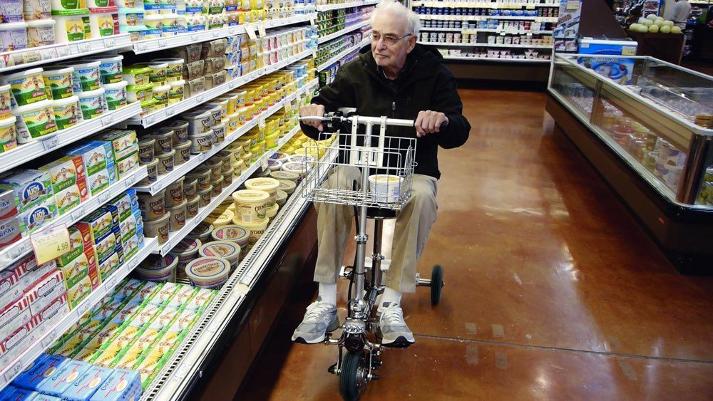Cy in Grocery with basket blk wheels